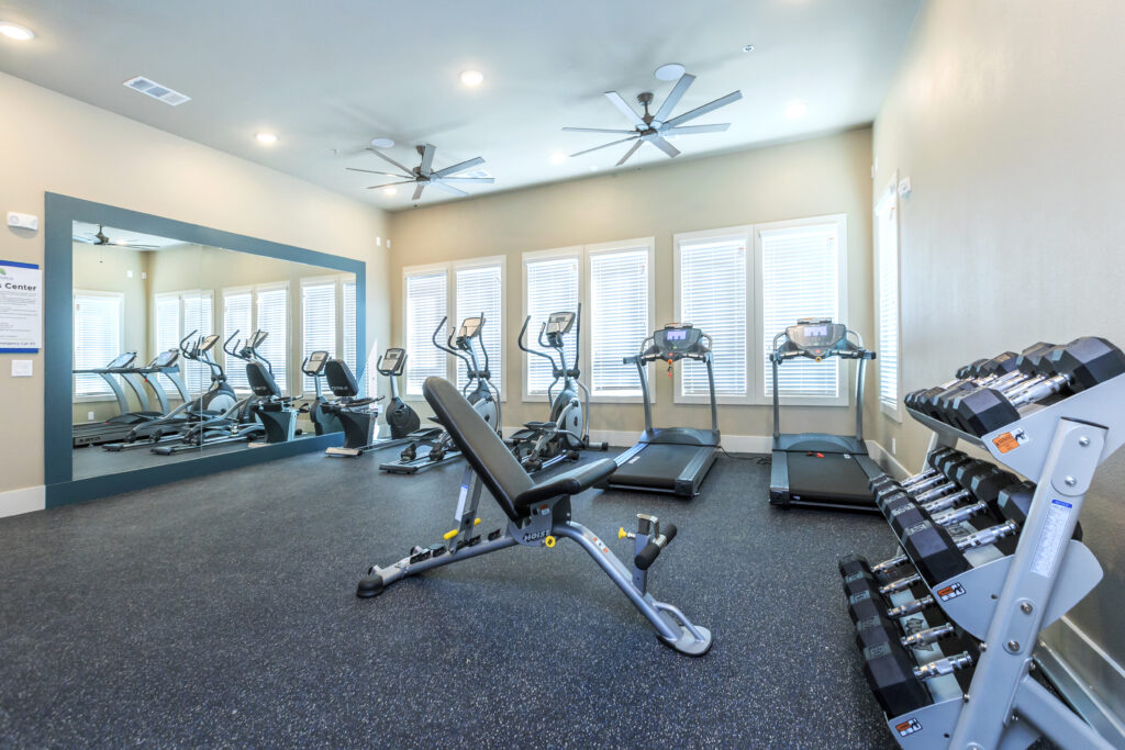 Campus Apartments exercise room with fitness equipment.